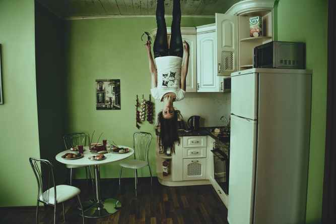 girl upside down in kitchen