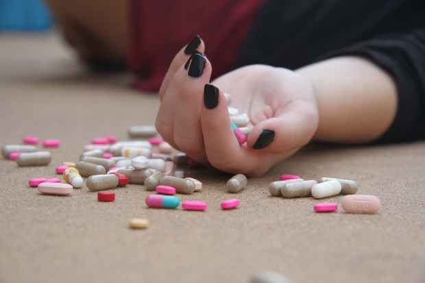 girl with pills.jpeg
