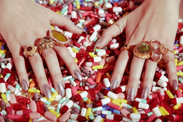 hands-in-tons-of-prescription-drugs-pills